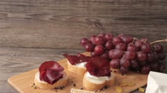 Healthy lifestyle plate of meat with grapes on wooden background - stock footage