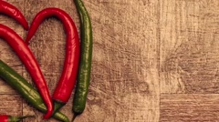 Stock Video Footage of On top view of chili, sweet pepper and spicy pepper on wooden background. Health