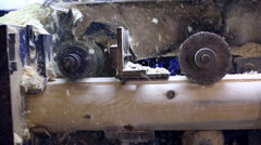 Milling cutter cuts log and sawdust fly away Stock Footage