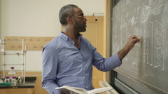 Chemistry Teacher Writes on Chalk Board HD Stock Footage