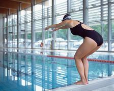 Female swimmer preparing to dive Stock Photos
