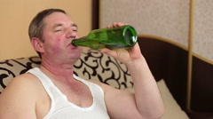 Lazy fat man watching Tv and drink beer Stock Footage