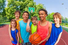 Basketball teenage team standing close after game - stock photo