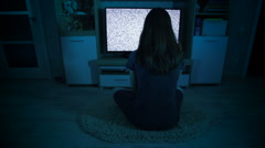 Creepy girl waching TV with grain - stock footage