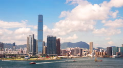 View toward Kowloon office buildings and architecture from Hong Kong harbour 4K - stock footage