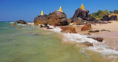 Buddhist stupa on rock on Ngwe Saung beach in Myanmar. Burma travel destinations Stock Footage