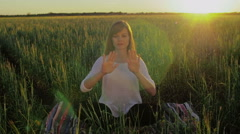 Woman in field make gestures for motion graphics - stock footage