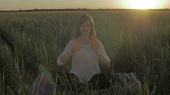 Stock Video Footage of Woman in field make gestures for cgi flat color