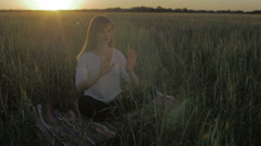 Woman in field make gestures for cgi effects flat - stock footage