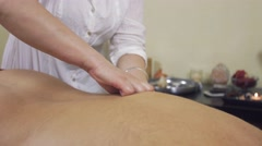Close up of masseuse hands pinch a back of adult fat man. Therapeutic massage - stock footage