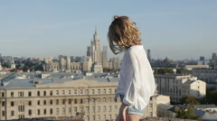 The beautiful girl model posing on the roof of an abandoned building. Stock Footage