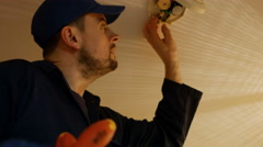Man fixing the fire detector Stock Footage