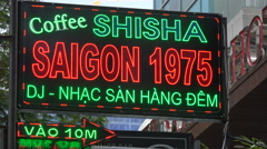 Coffee house in Saigon, culture, drinking, neon billboard, advertising, Vietnam Stock Footage