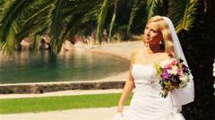 Charming blond bride walking with flowers on Montenegro, Budva - stock footage