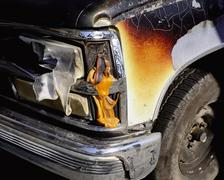 Melted automobile headlight Stock Photos