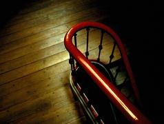 Banister and wooden stairway - stock photo