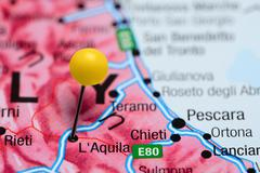 L Aquila pinned on a map of Italy - stock photo
