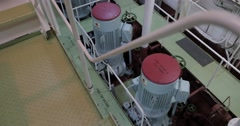 Electric motors and pumps in engine room. Stock Footage