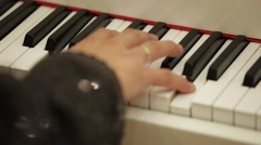 Pianist Playing on a Piano Keyboard - stock footage
