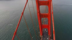 A climbing shot looking down at traffic on the Golden Gate bridge Stock Footage
