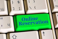 Online Reservation on keyboard - stock photo