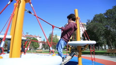 Portrait of the cute little boy  playing at the playground - stock footage