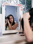 Girl cutting her own hair Stock Photos