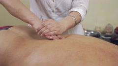 Close up masseuse hands press backbone of fat man by one hand. Therapeutic Stock Footage