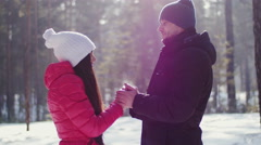 Man warming hands to his girlfriend - stock footage