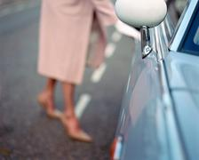 Woman opening automobile door Stock Photos