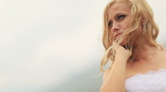 Beautiful blond bride softly touching her face close up Stock Footage