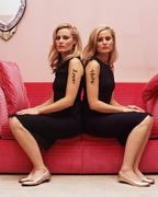 Two women with love and hate tattoos Stock Photos