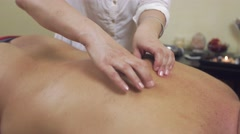 Close up of masseuse hands finger over back of adult fat man. Remedial massage - stock footage