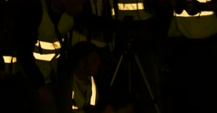 Photographers in Reflective Vests in Airport at Night Stock Footage