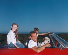 Father taking children and dog on a road trip Stock Photos