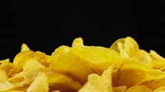 Potato Chips Rotating on Black Background - stock footage