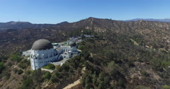 Griffith Observatory with Hollywood Sign in the background Stock Footage