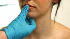 Surgeons making injection on woman Stock Footage