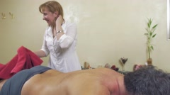 Adult fat man turn over and lie on back. Therapeutic massage. Medium shot Stock Footage