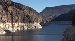 Colorado river water level on the rocks - Hoover dam hydroelectric power station - stock footage