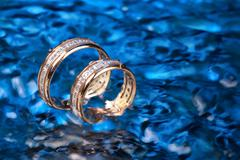 Golden Rings In The Water Stock Photos