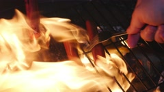 Cooking Hot Dogs on a Camp Fire Stock Footage