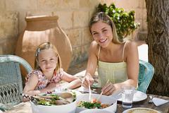 Mother and daughter dining al fresco Stock Photos