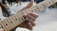 Street artist plays electric guitar live in busy city street,slowmotion Stock Footage