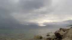 Changing weather in the mountains over the sea Stock Footage