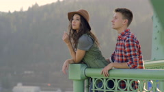 Couple Enjoy The View From St Johns Bridge, Woman Points To Something Stock Footage