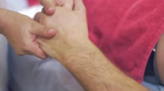 Close up of masseuse hands make professional massage of hand hand to adult man Stock Footage