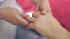 Close up of masseuse hands make massage of hand fingers to adult man. Healing Stock Footage
