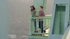 Cute Couple Enjoy View From St Johns Bridge, Woman Spreads Her Arms Stock Footage