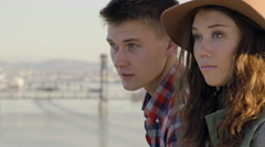 Couple Enjoy View Of River, Woman Rests Her Head On Her Boyfriend's Shoulder Stock Footage